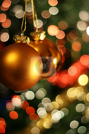 Christmas golden ball stock photo, Christmas golden ball with a light blur creating bokeh in the background by Laurent Renault