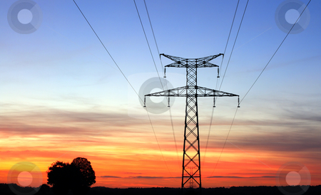 High Energy stock photo, Electricity pylons, over a sunset sky by Laurent Renault