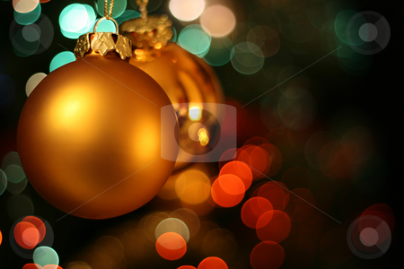Christmas golden ball card stock photo, Christmas golden ball with a red and green light blur creating bokeh in the background by Laurent Renault