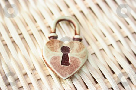 Locked heart stock photo, Conceptual representation of a closed heart. Wattled background shallow depth of field by Natalia Macheda