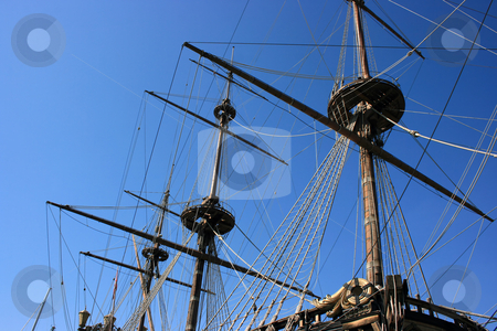 Masts of ancient battleship stock photo, Fragment of an old sailing and oared battleship: three masts with complicated tacking. Port of Genoa, Italy by Natalia Macheda