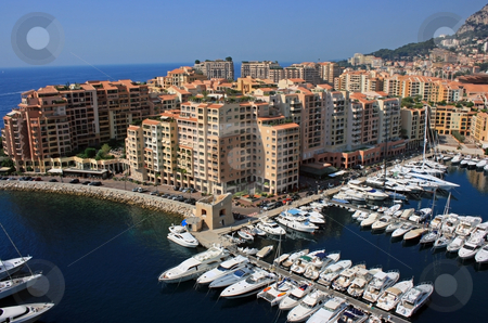 Monaco harbor stock photo, A fragment of Monte Carlo city and its harbour with yachts and motor boats. by Natalia Macheda