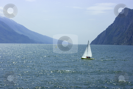 Sailing on Lake Garda stock photo, Enjoyable sailing on a small boat on Garda Lake by Natalia Macheda