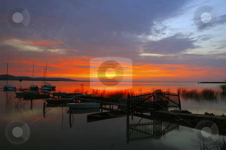 Sunrise at Balaton stock photo, Small boats at sunrise lake Balaton, Hungary by Csaba Zsarnowszky