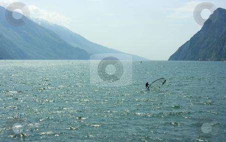 Surf-riding on Garda lake stock photo, Surfer practicing sports activity on Garda lake by Natalia Macheda