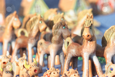 Toy horse stock photo, Many joyful toy horses and cows made of clay. Shallow depth of field by Natalia Macheda