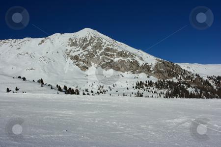 Winter mountain peak stock photo, Dolomites peak view from a ski trace by Natalia Macheda
