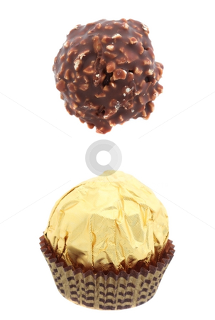 Chokolate sweets stock photo, Chocolate sweet with and without foil isolated over white by Natalia Macheda