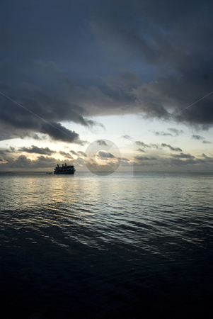 Boat at Sunset stock photo, Boat on the cloudy sunset in Micronesia by A Cotton Photo