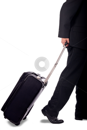 Business man with luggage stock photo, Business man walking with pull-behind luggage by Vince Clements