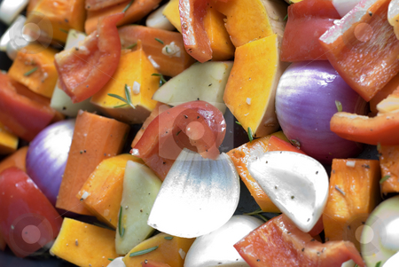 Roast vegetables stock photo, A tray of colourful vegetables ready for roasting by Stephen Gibson