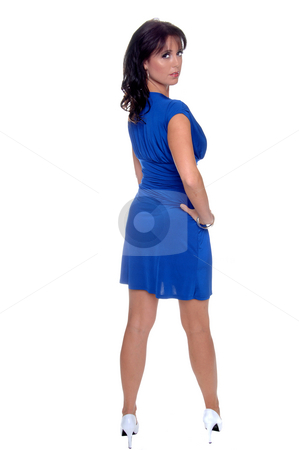 Woman in Blue Dress stock photo, Beautiful brunette in a sleek blue cocktail dress and wite high heels by Robert Deal