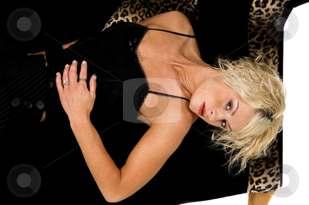 Pretty Blond Laying On Couch stock photo, Pretty blonde fashion model with short blond hair laying on a black and lepoard print couch by Robert Deal