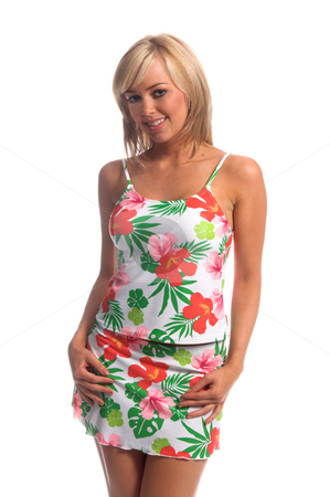 Hibiscus Tankini Blonde stock photo, Sexy blond swimwear model ina white tankini with a large and bold pink and green Hibiscus flower print. Hands at sides slight tilt to shoulders by Robert Deal