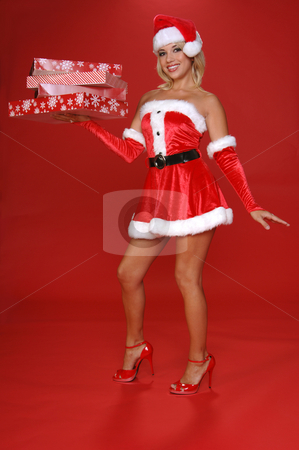 Santa's Christmas Helper stock photo, Santa's sexy helper delivering an armload of christmas gifts by Robert Deal