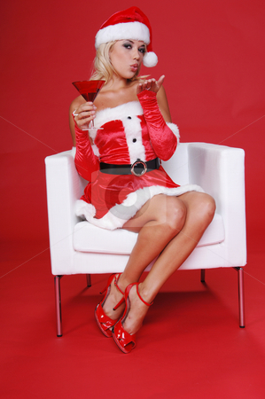 Christmas Martini stock photo, After a long days work Santa's sexy helperblows a kiss and relaxes with a fresh Christmas Martini. by Robert Deal