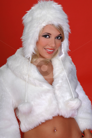 Fuzzy Snow Bunny stock photo, Sexy blond snow bunny in a white furry coat and hat s over a red background by Robert Deal