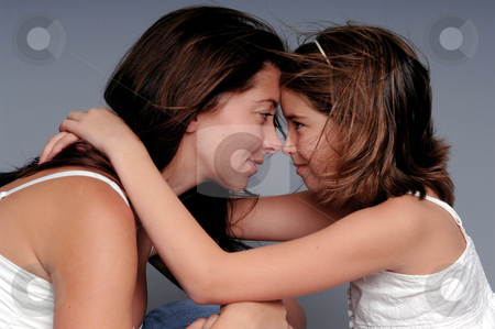 Mother Daughter stock photo, A young mother shares an intimate moment with her adolescent daughter. by Robert Deal