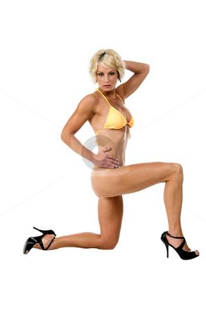 Blond in Yellow Bikini stock photo, Sexy blond swim wear model in a yellow bikini by Robert Deal