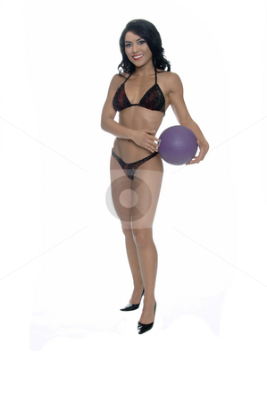 Bikini Volleyball stock photo, Beautiful young Latina fitness model in a multicolored sequinedbikini with a purple volleyball by Robert Deal