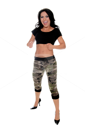 Hispanic woman in camo pants stock photo, Sexy young latin woman in a black t-shirt and camo pattern pants playfully yells while beating on her well toned abs by Robert Deal