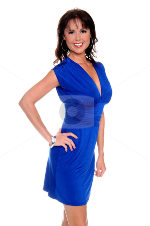 Woman in Blue Dress stock photo, Beautiful brunette in a sleek blue cocktail dress with a big smile and her hand on her hip by Robert Deal