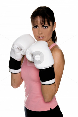 Female Boxer in Fight Stance stock photo, Healthy young woman in white boxing glove takes her fighting stance during a boxing workout. by Robert Deal