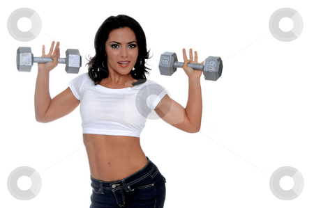 Woman latina workout Trainer stock photo, Young female personal fitness trainer in designer jeans and a half t-shirt holding a pair of 15 pound dumbells by Robert Deal