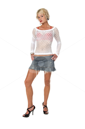 Orange County Blonde stock photo, Sexy OC blonde fashion model in a denim skirt, net top and red bra and big hoop earrings  Full body shot isolated over white. by Robert Deal