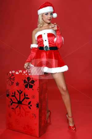 Santa Wants You stock photo, Sexy Mrs Santa with a large bag full of christmas gifts points her finger at the viewer by Robert Deal