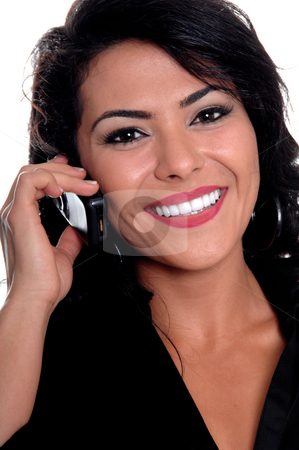 Mexican Woman talking On Cell Phone stock photo, Beautiful young latina business woman talking on a cell phone by Robert Deal