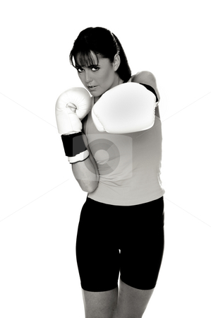 Female Boxer stock photo, Healthy young woman in white boxing  gloves shoots a strong left cross during a boxing workout. by Robert Deal