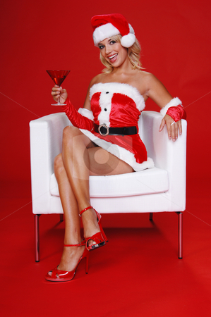 Christmas Martini stock photo, After a long days work Santa's sexy helper relaxes with a fresh Christmas Martini and a smile. by Robert Deal