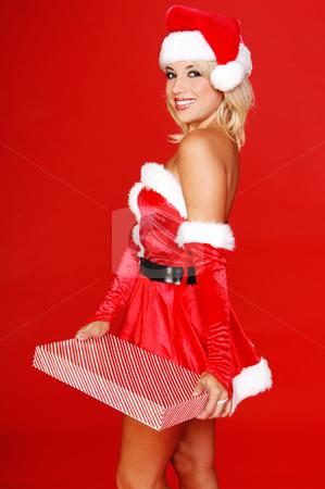 Santa's Christmas Helper stock photo, Santa's sexy helper with a christmas gift by Robert Deal