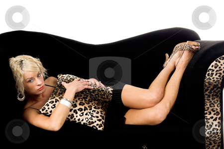 Sad Blond Laying On Couch stock photo, Pretty blonde fashion model with short blond hair laying on a black and lepoard print couch looking very sad and depressed by Robert Deal
