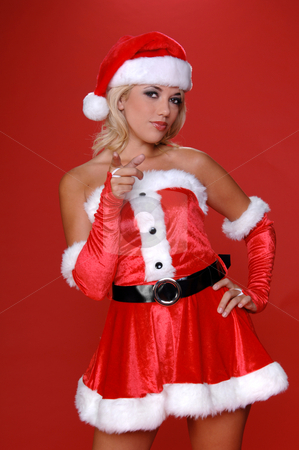 Mrs. Santa Points stock photo, Sexy blond Mrs Santa in a red velvet suit points her finger at the viewer.  Half body image by Robert Deal