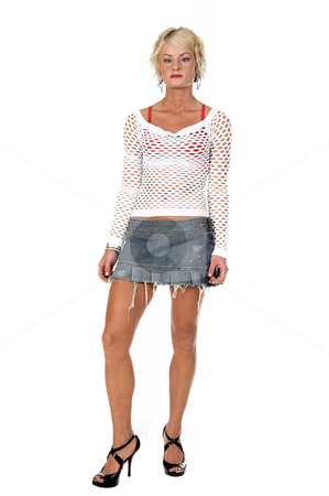 Orange County Blonde stock photo, Sexy OC blonde fashion model in a stringy denim skirt, net top and red bra.  Full body shot isolated over white. by Robert Deal