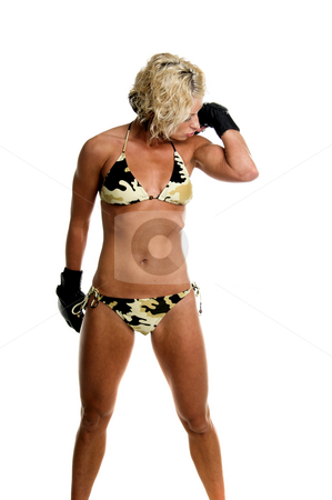 Female MMA Fighter stock photo, Sexy blond mixed martial arts fighter in a camo bikini and MMA style gloves kissing her guns by Robert Deal