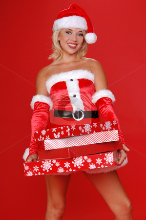 Santa's Christmas Helper stock photo, Santa's sexy helper delivering a big arm load of christmas gifts by Robert Deal