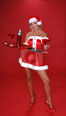Christmas Martini stock photo, After a long days work Santa is greeted by his sexy helper with a fresh Christmas Martini.  Full body by Robert Deal