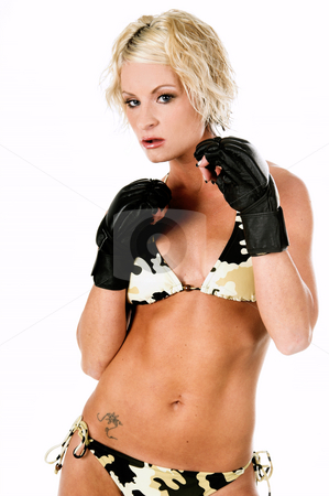 Female MMA Fighter stock photo, Sexy blond mixed martial arts fighter in a camo bikini and MMA style gloves ready to fight by Robert Deal