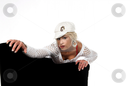 Pretty Blonde Headshot stock photo, Head shot of a pretty blonde in a white mesh top and cap with short hair and a nice smile leaning over a chair by Robert Deal