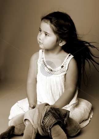 Little Girl  On Grey stock photo, Little girl sitting on a grey background and holding a stuffed toy by Robert Deal