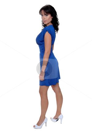 Woman in Blue Dress stock photo, Beautiful brunette in a sleek blue cocktail dress by Robert Deal