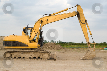 Backhoe stock photo, Full view of a large backhoe sitting idle by Richard Nelson