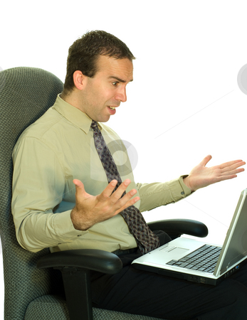 Work Frustration stock photo, A young businessman sitting in his chair, getting mad at the laptop by Richard Nelson