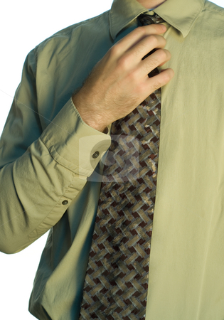 Man Adjusting His Tie stock photo, Closeup view of a man adjusting his tie, isolated on a white background by Richard Nelson