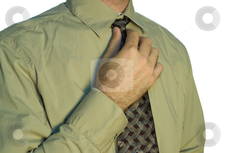 Getting Ready For Work stock photo, A man adjusting his tie for work by Richard Nelson