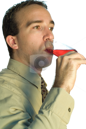 Worker Drinking Wine stock photo, A young caucasian businessman drinking a glass of wine by Richard Nelson