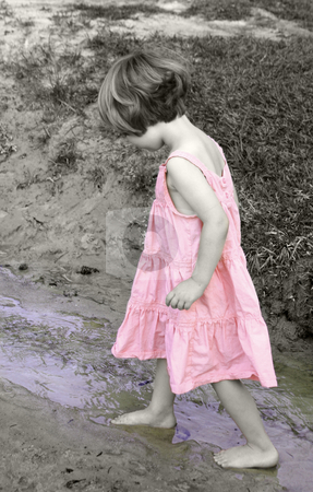 Wading stock photo, Little girl in colorized black and white wading in a creek by Anita Peppers